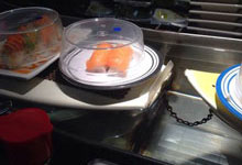 Water kaiten conveyor, sushi floats on boats from a kitchen to the client's table