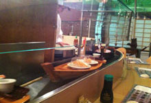 Water kaiten conveyor, sushi float on boats from a kitchen to the clients table