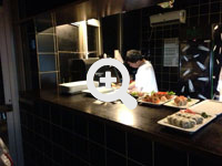 Sushi restaurant - who uses sushi robots, sushi machines, and sushi equipment